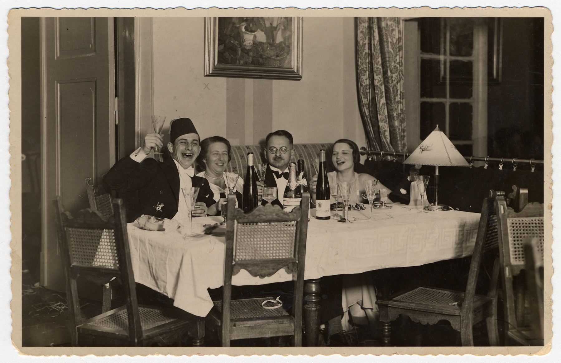 Two German-Jewish couples toast in the New Year.  Seated on the right are Dr. Hans Adolf and Augusta Brager Bujakowski.