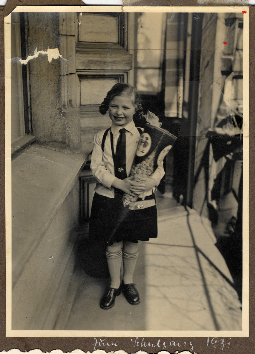 Helga Bujakowski holds a large cone filled with treats on her first day of school.