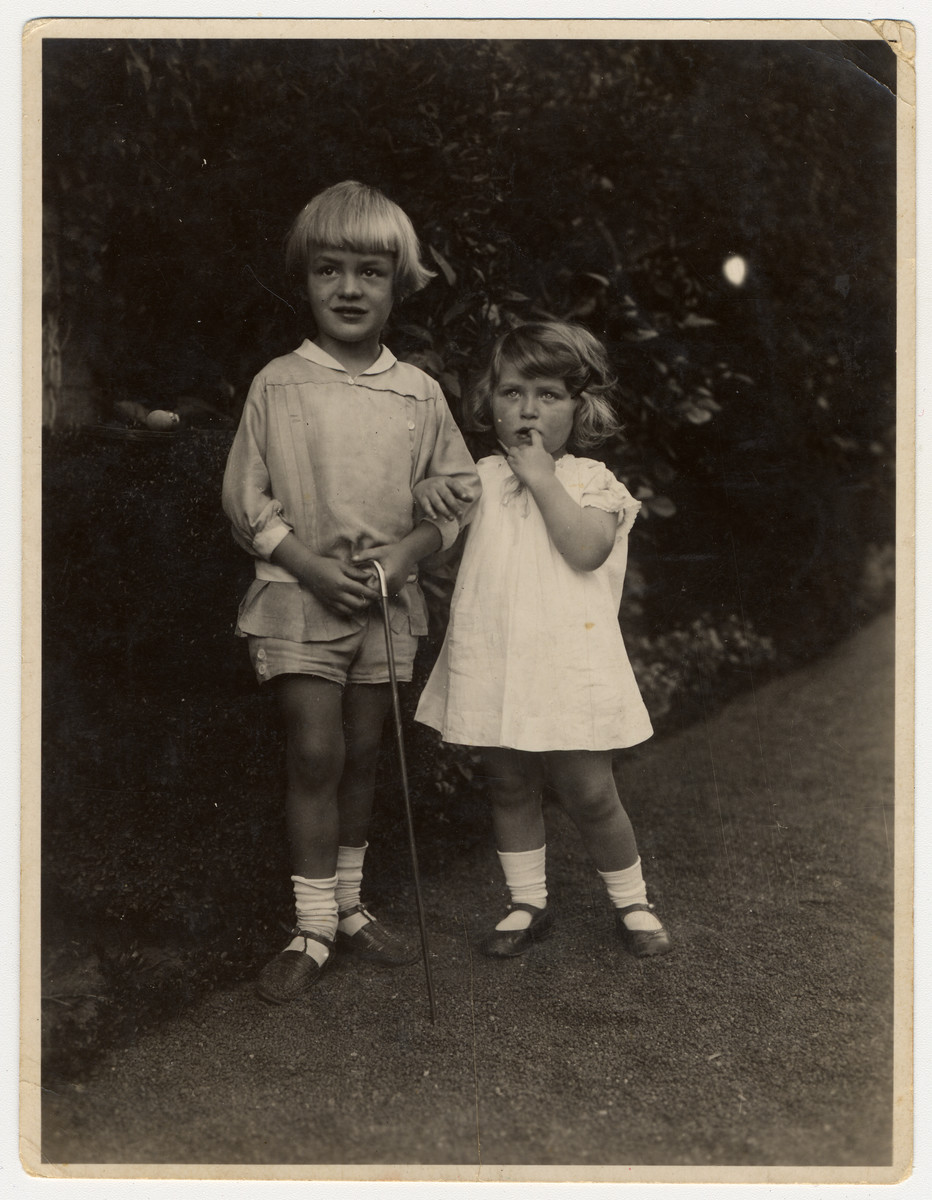 Two young children pose together in a garden in Bremen.  The boy, Tobias (Bubi) Tobek, later joined the Hitler Youth.  The girl, Helga Bujakowski, was Jewish and later emigrated from Germany.