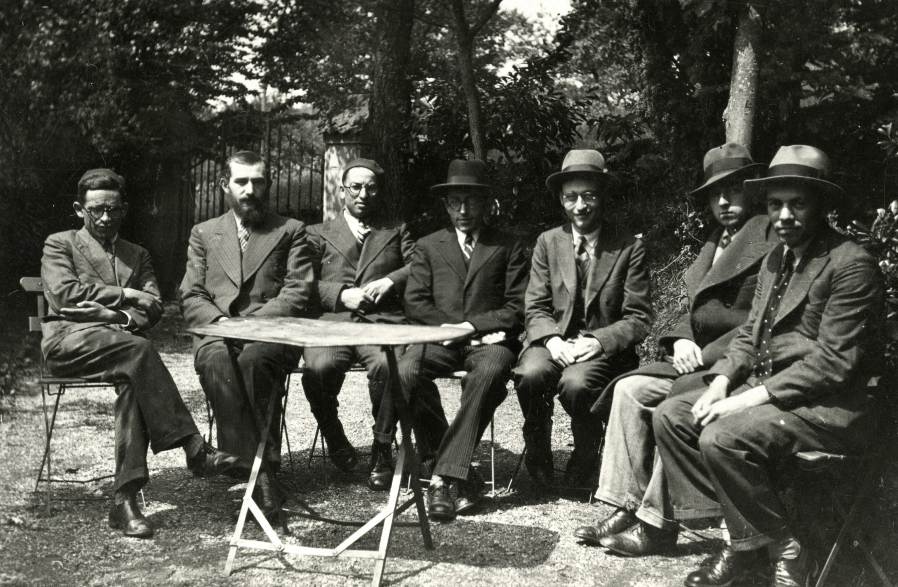 Group portrait of rabbinical students or young rabbis [probably in France].  Rabbi Moise Cassorla is seated third from the left.