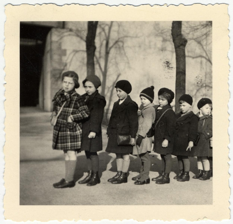 Kindergarten children in Ludwigshafen walk to school holding hands.
