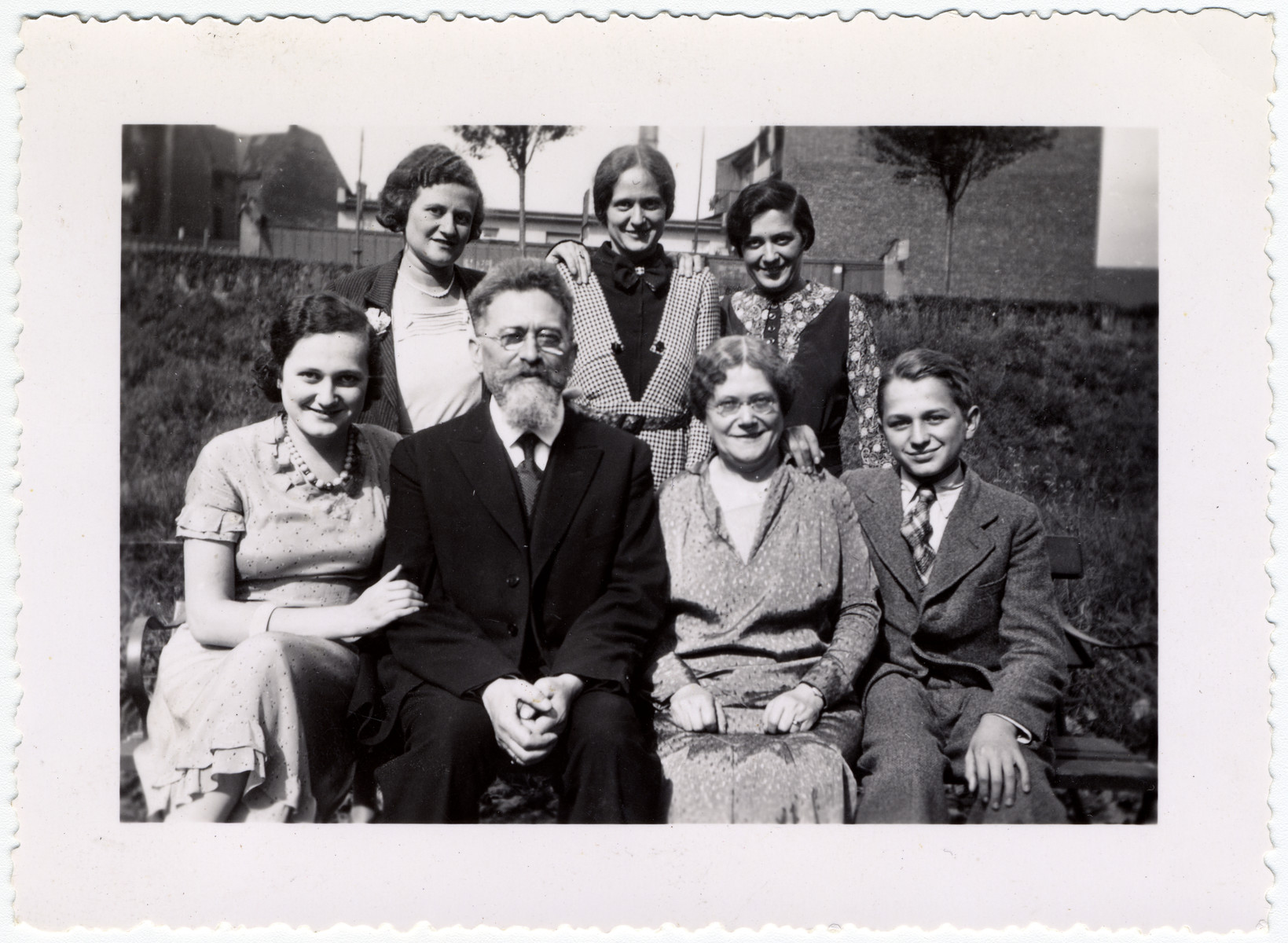 Group portrait of the Wetzler family.  Pictured in the center are Salomon Wetzler and his wife.  Their son Edgar is seated on the right.  Lilly (later Weilheimer) is standing in the center.  Also pictured are Nelly (later Stern), Alice (later Strassburger) and Emmy (later Rosenfelder).