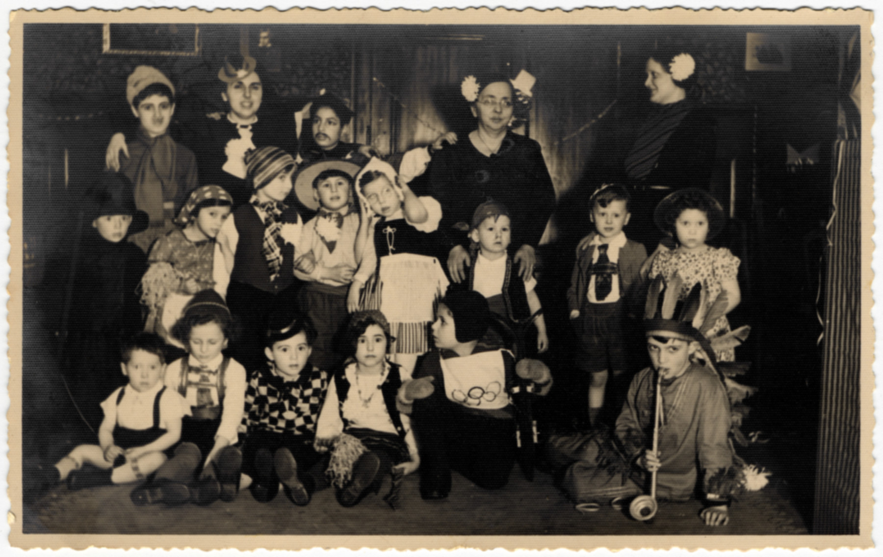 Group portrait of children in the Jewish kindergarten of Ludwigshafen dressed in Purim costumes.