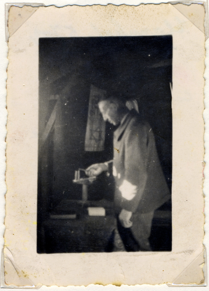 Max Weilheimer lights Channuka candles in the Gurs internment camp.  This is the last photo that was taken of Max Weilheimer prior to deportation and death.