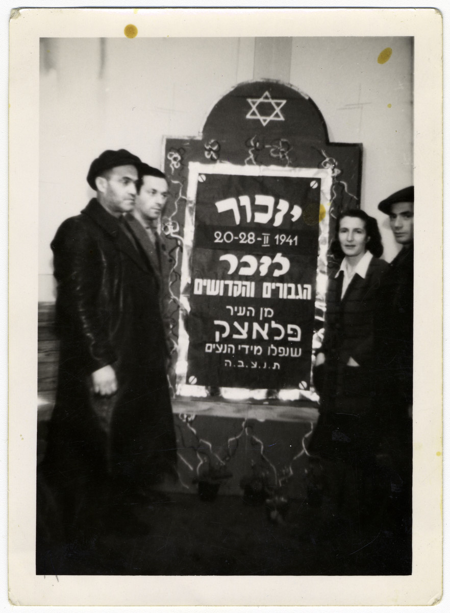 A Jewish family visits the graves of their family members after the war.