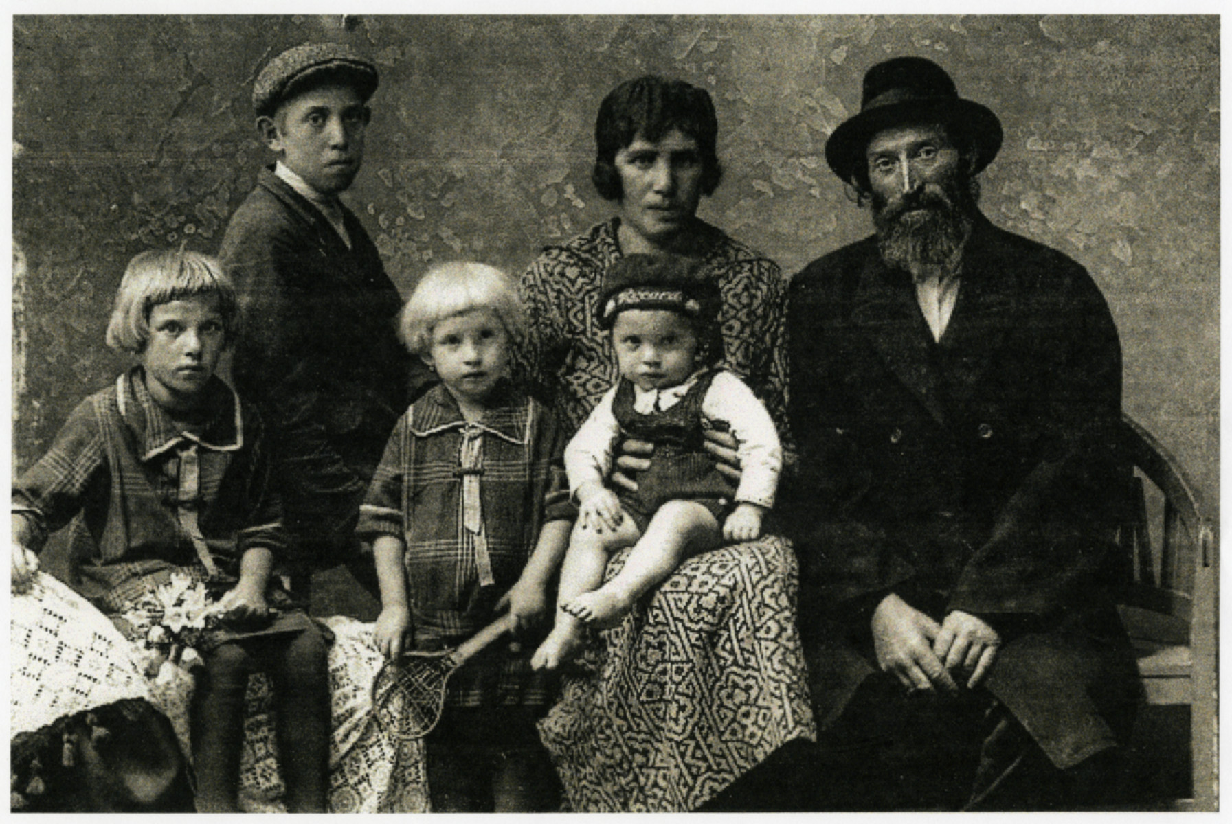 Prewar studio portrait of the Berkowitz family.  Pictured from left to right:  Toby, a stepbrother who died before the war, Leah, Fradel, Herschel (seated on her lap) and Eliyahu.