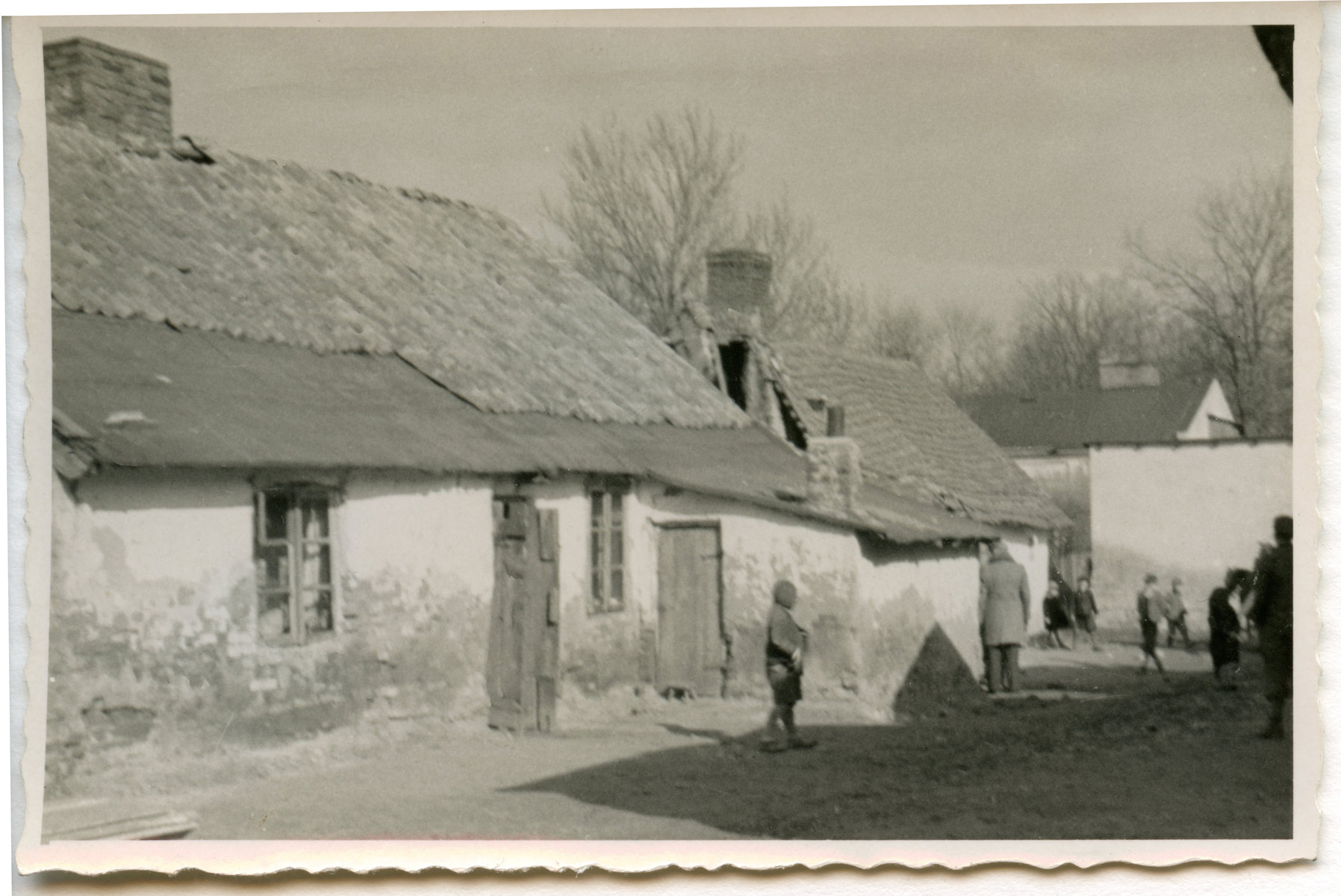 View of a street [perhaps in Osieciny].