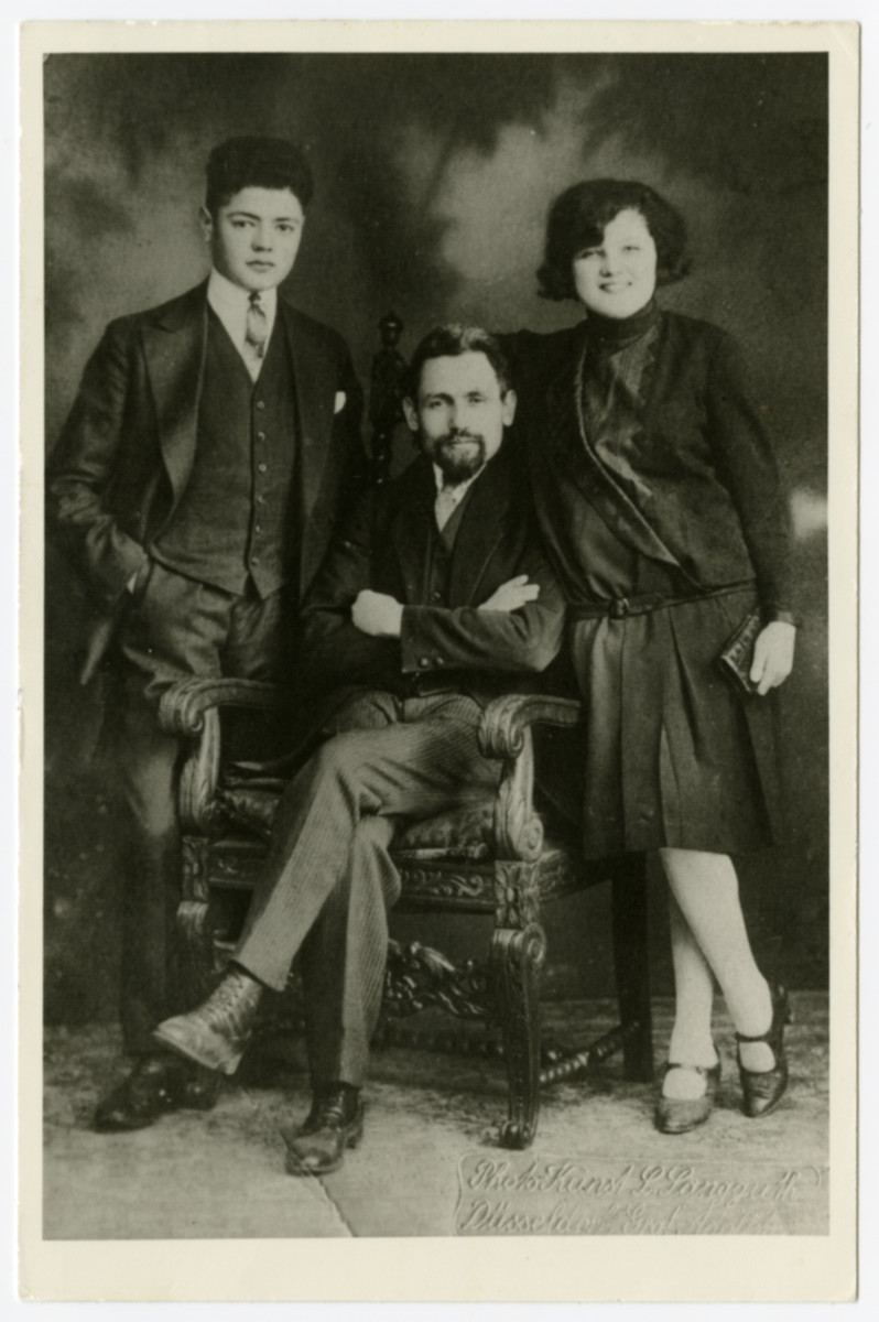 A portrait of the Eimer family.    Pictured are Mendel Eimer (center) with two of his children, Louis and Klara.