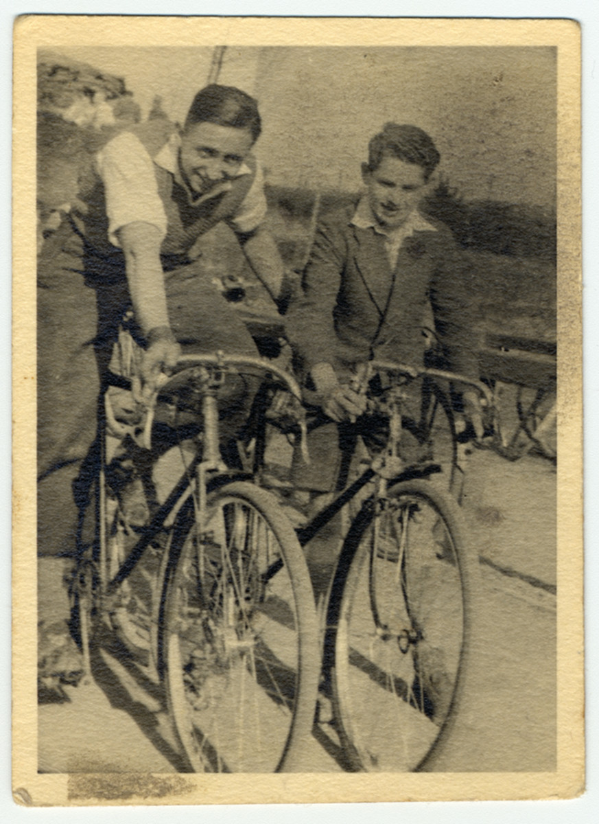 Hans Kahan and Fredi Fenster ride their bicycles..