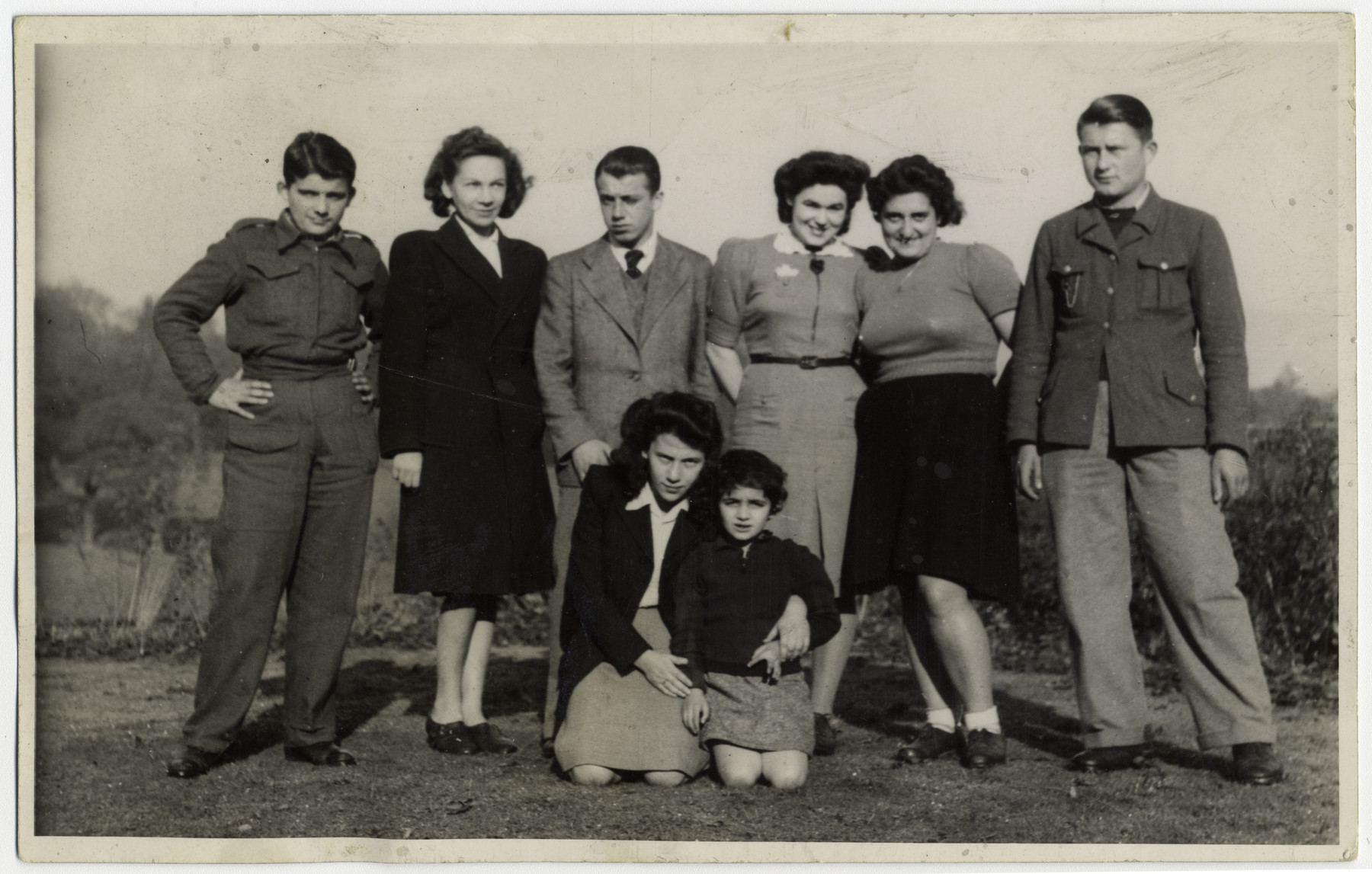 Child survivors pose in Windermere, England.  Kneeling in center is Tosca Sussman with a little girl Judith.