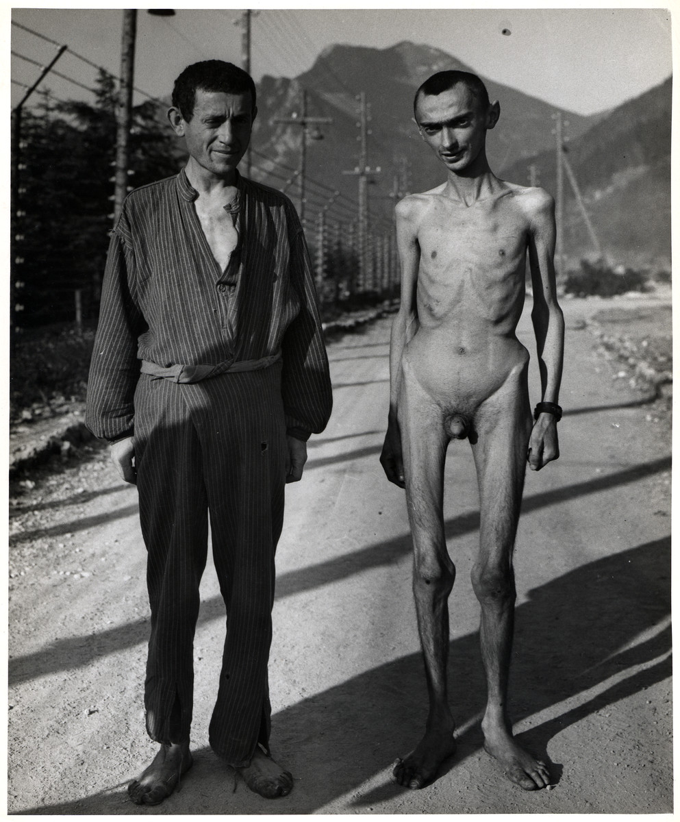 Close-up portrait of two emaciated survivors [probably in the Ebensee concentration camp].