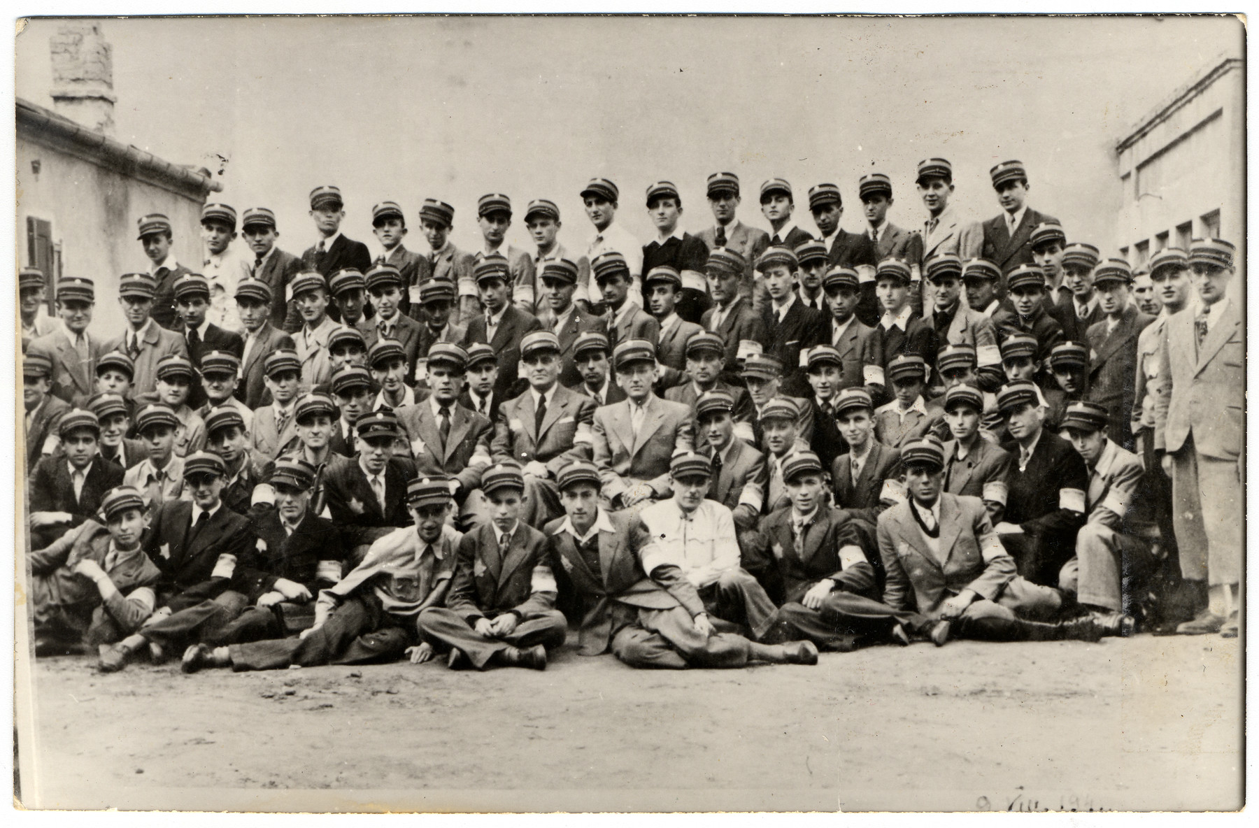 Group portrait of uniformed postal workers in the Lodz ghetto.  [Photo is a dupe of 25199.]
