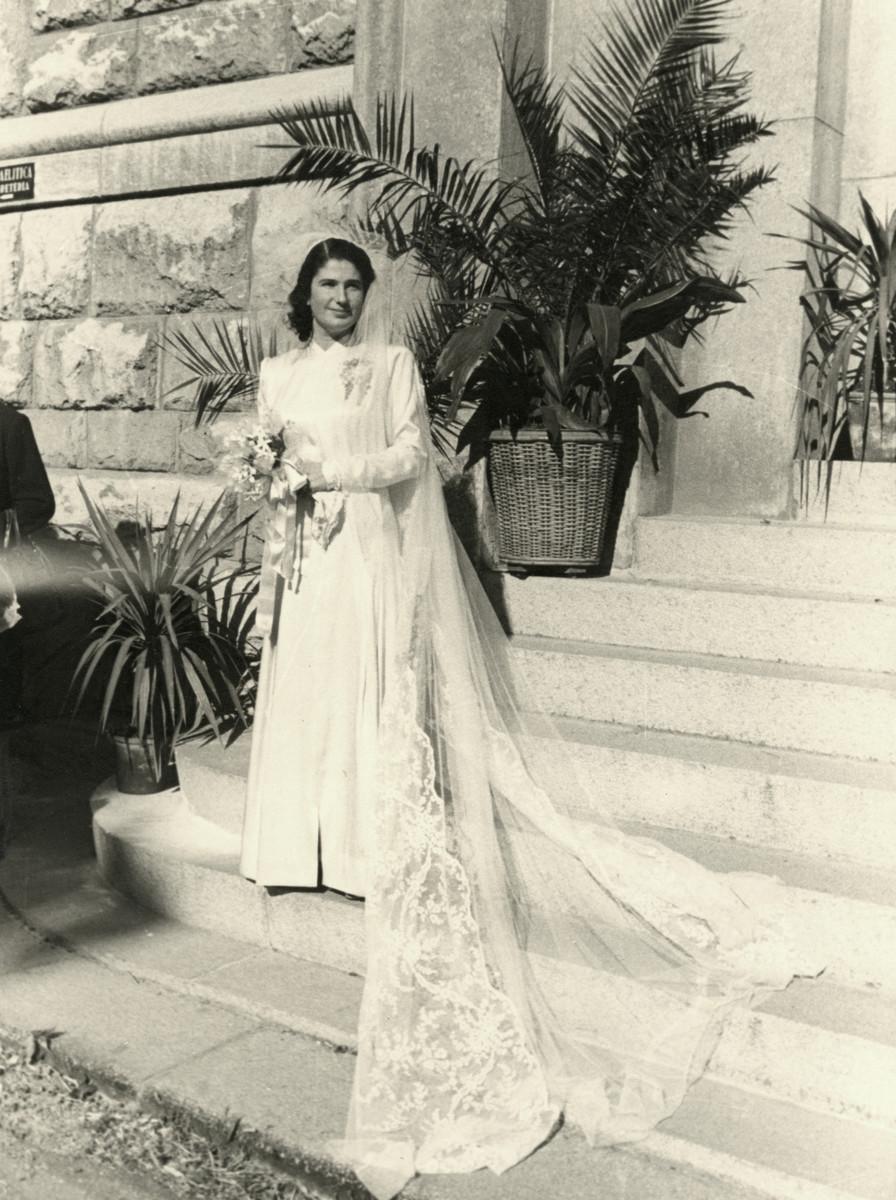 Liana Nizza poses on her wedding day in Genoa.