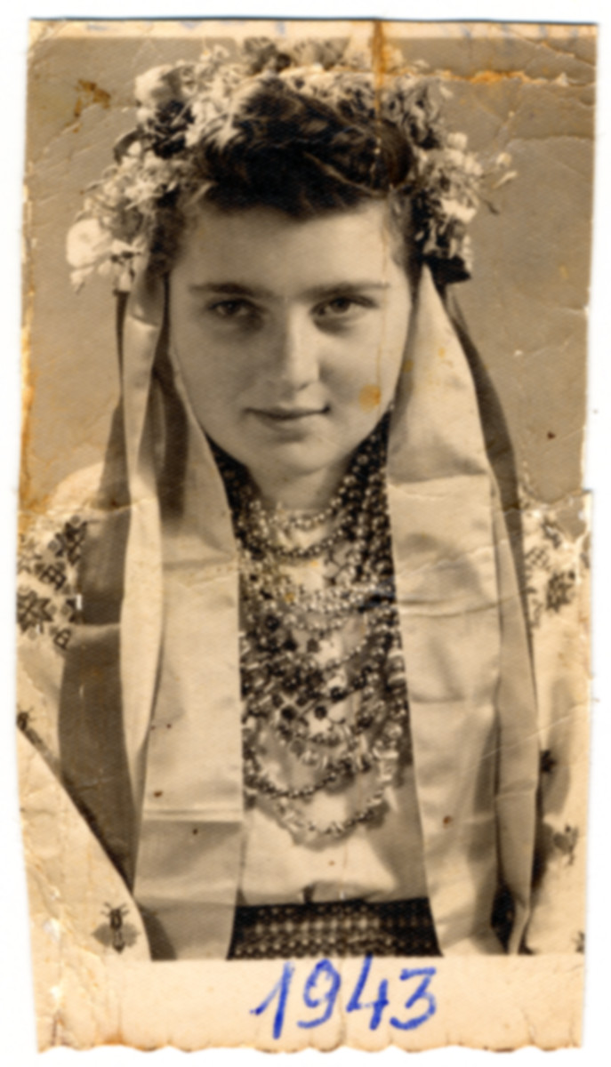 Studio portrait of Hanna (later Lewkowicz) wearing a traditional Polish costume while in hiding in a monastery near Lvov.