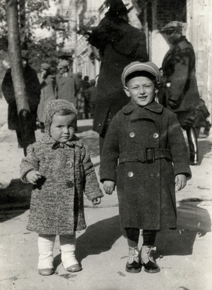 Zvia Korenzyer and her cousin walk down a street in Chelm, Poland.