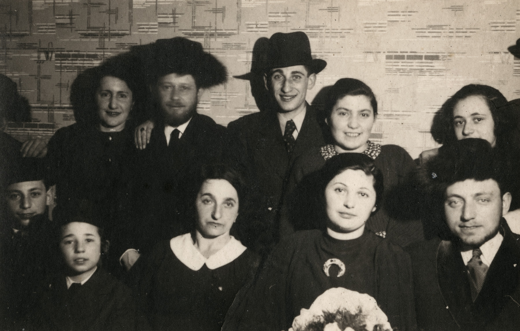 Group portrait of the extended Rotenberg-Widowsky family, Bobover Hasidim  Pictured are Haim Widowsky (originally Rotenberg) at the bottom with his cousins, his father Yehuda Rotenberg (wearing fur hat, second from left on top), his mother Sara nee Widowsky with white collar.