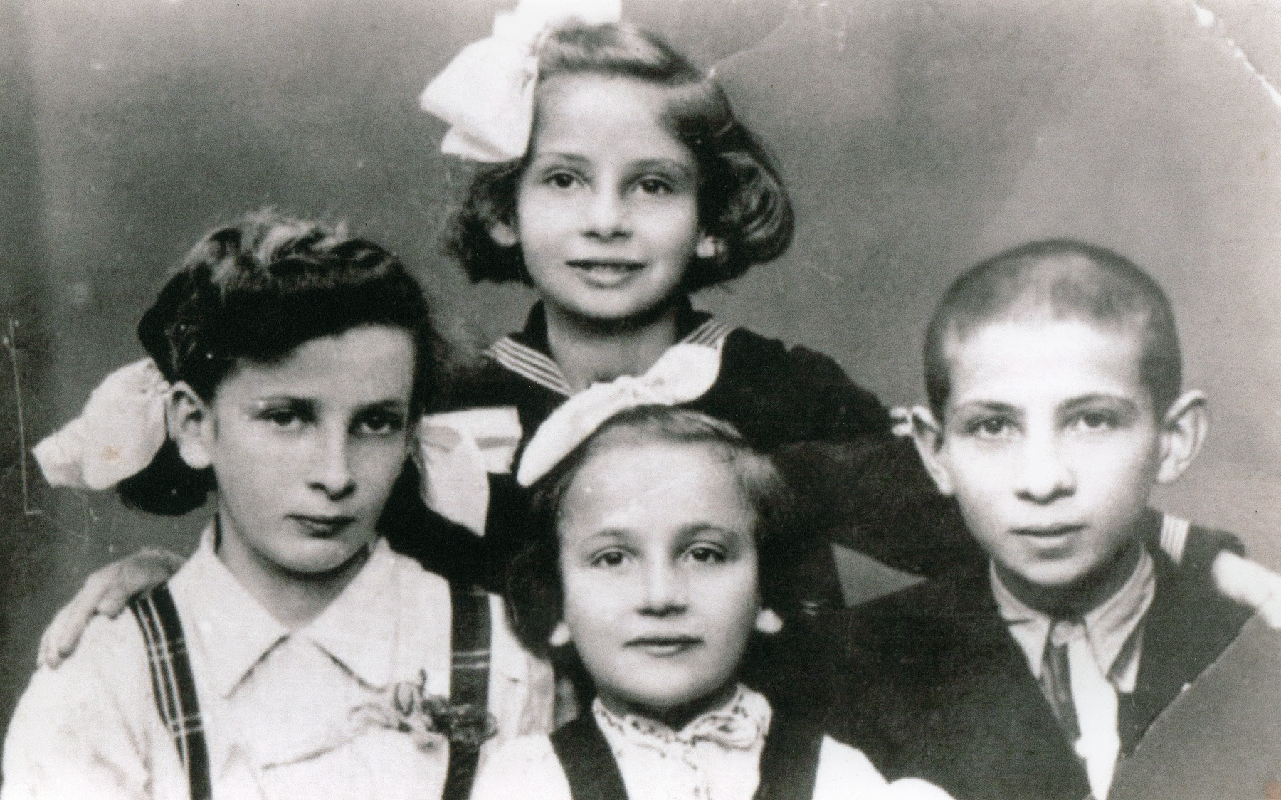 Yaffa, Sara, Tzippora and Shimon Landau.  The children escaped with their parents from Bochnia to Romania.