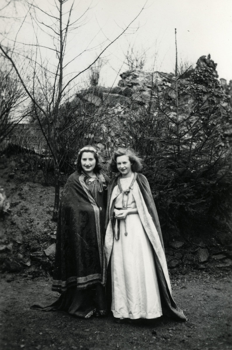 Two Jewish sisters in hiding pose together in costumes in the St. Antoine de Padue convent.