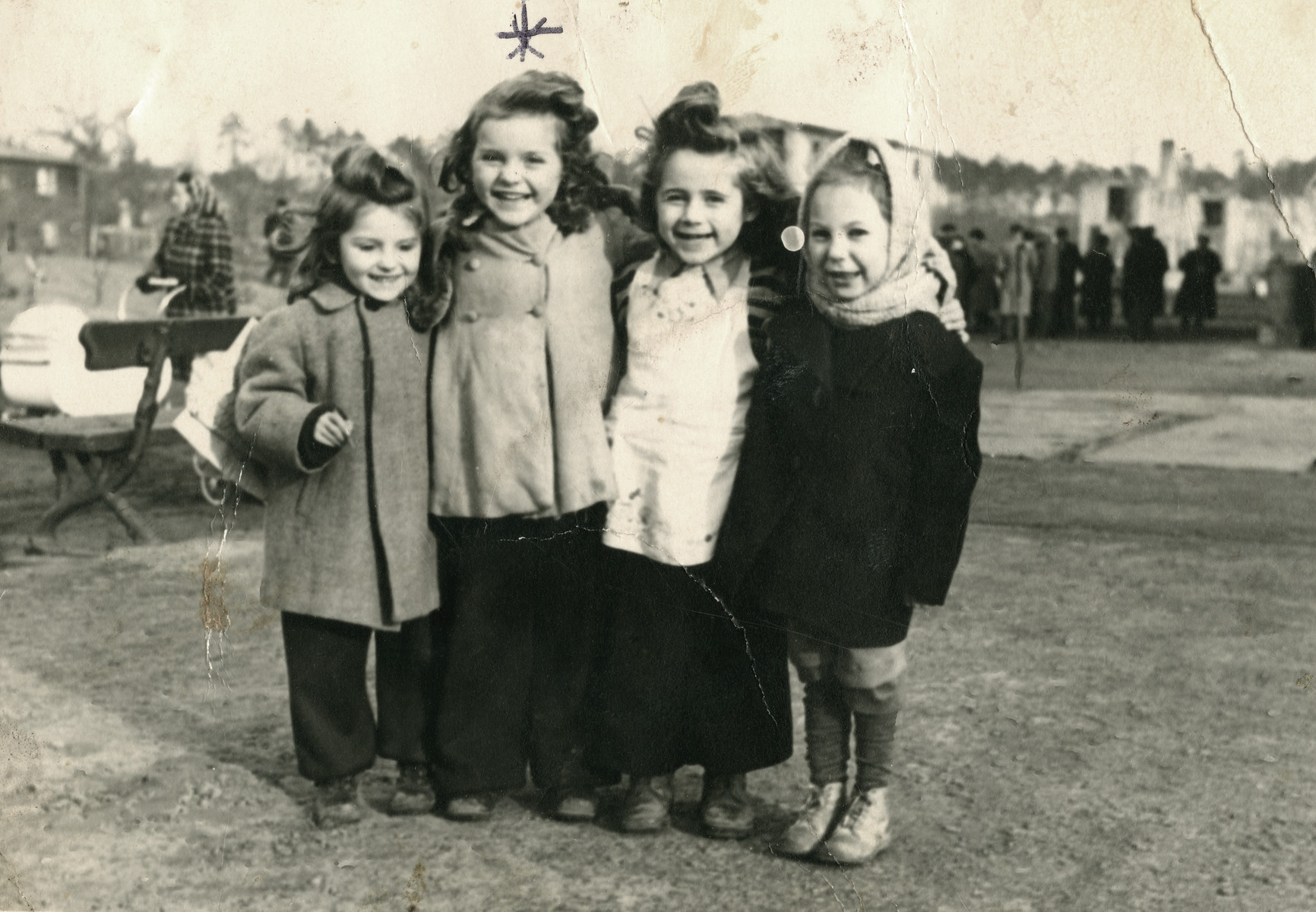 Clara poses with three other little girls at the Schlachtensee displaced persons camp.   Clara is the second girl on the left.