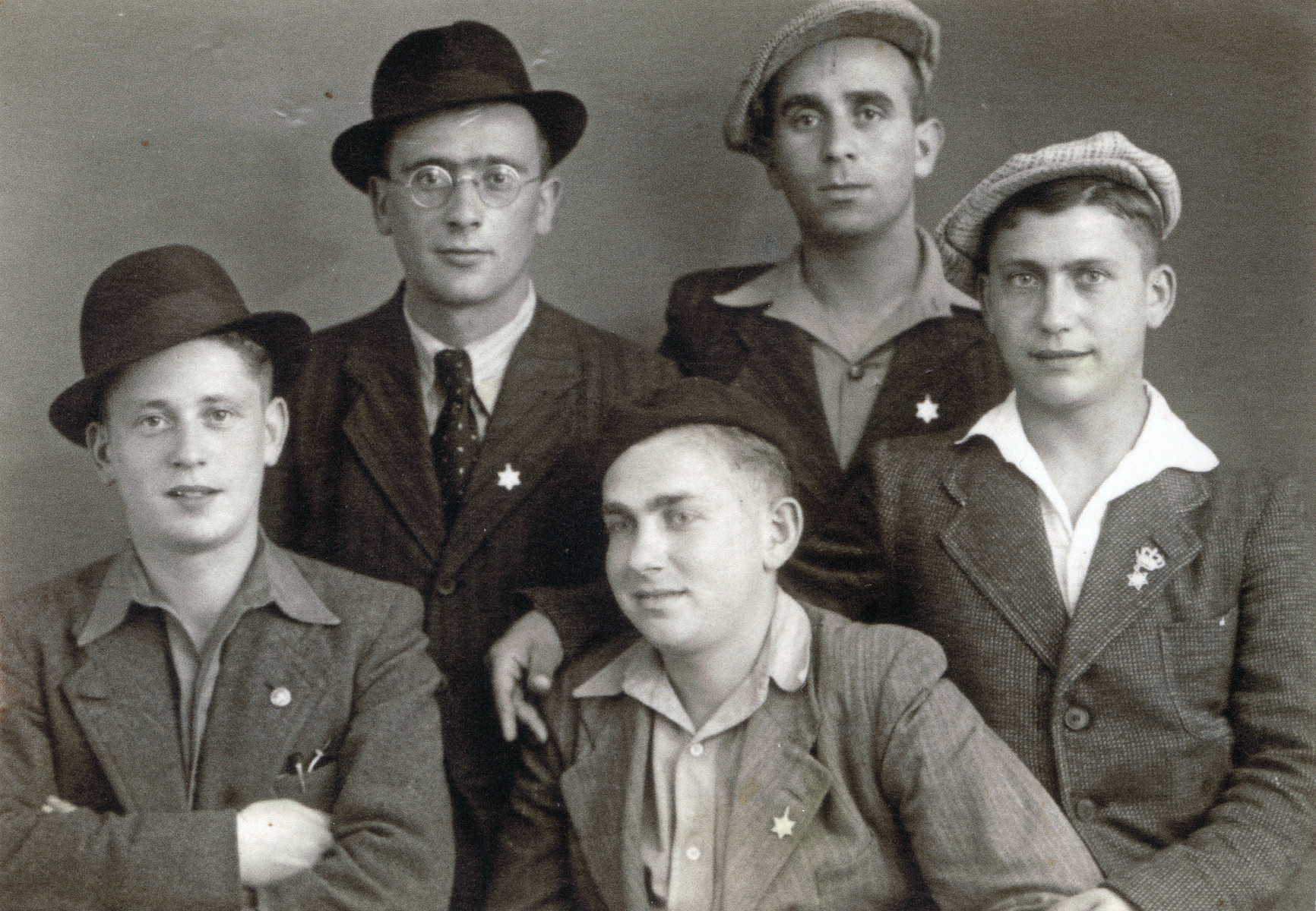 Group portrait of religious Jewish youth in an unidentified displaced persons camp.  Among those pictured are Moshe Braunfeld (lower left) and Leibish Braunfeld (right).  They sent this photograph to their sister Elissa in Palestine to prove they were still alive.