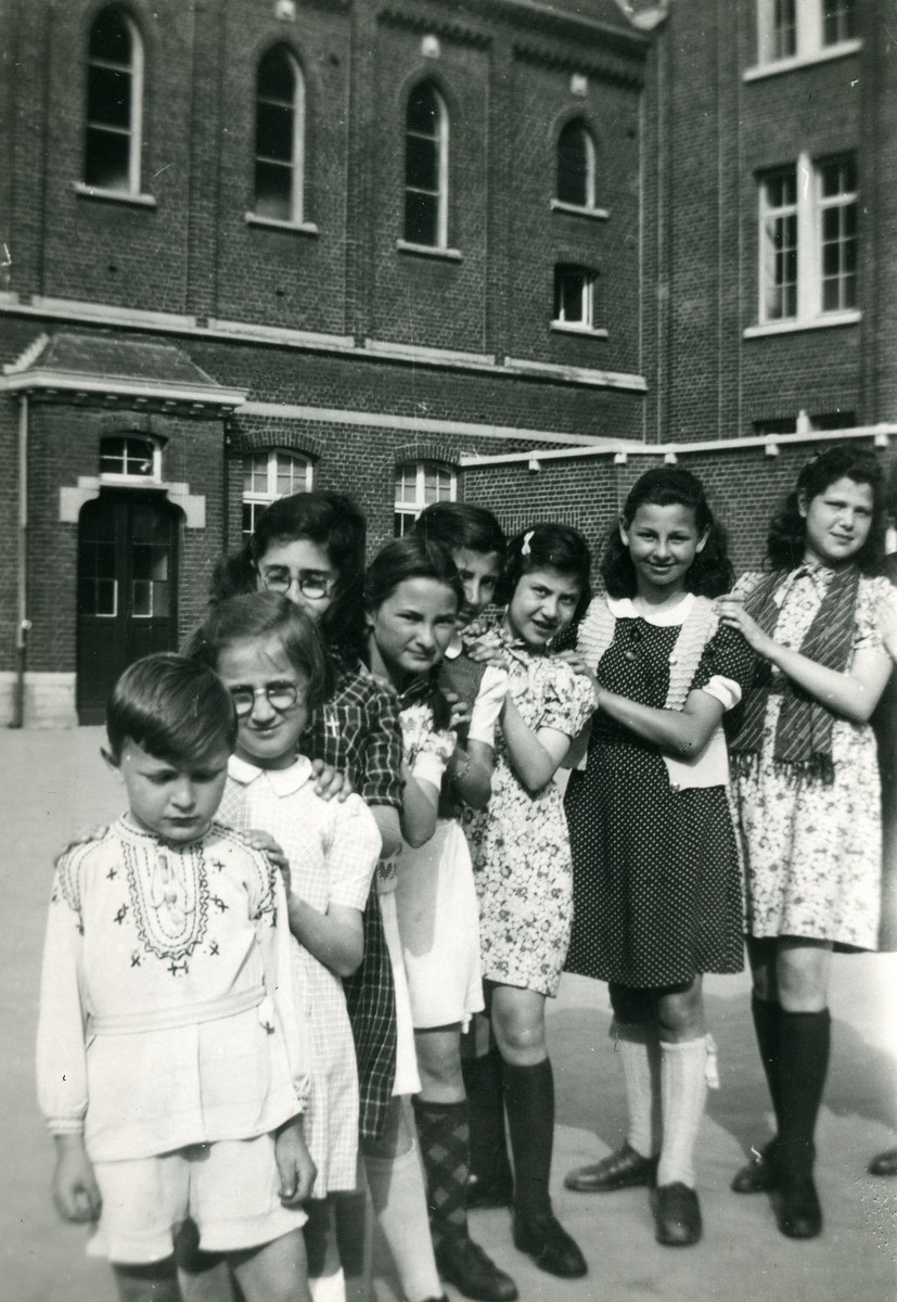 Children line up in the Convent St. Antoine de Padue.  Liliane Ferdman stands second in line behind boy with embroidered shirt,