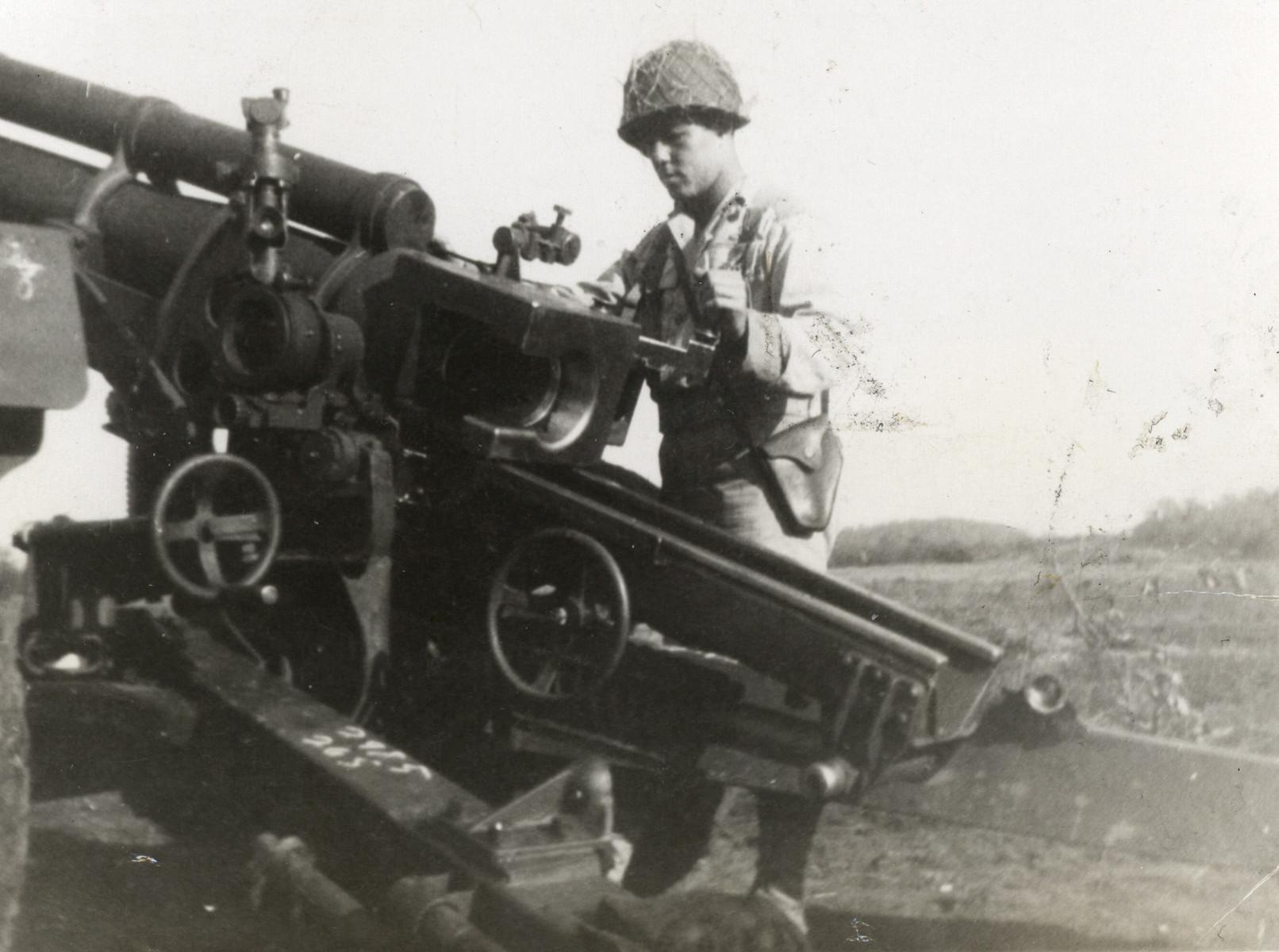 American Jewish soldier Hilbert Margol loads his artillery piece.