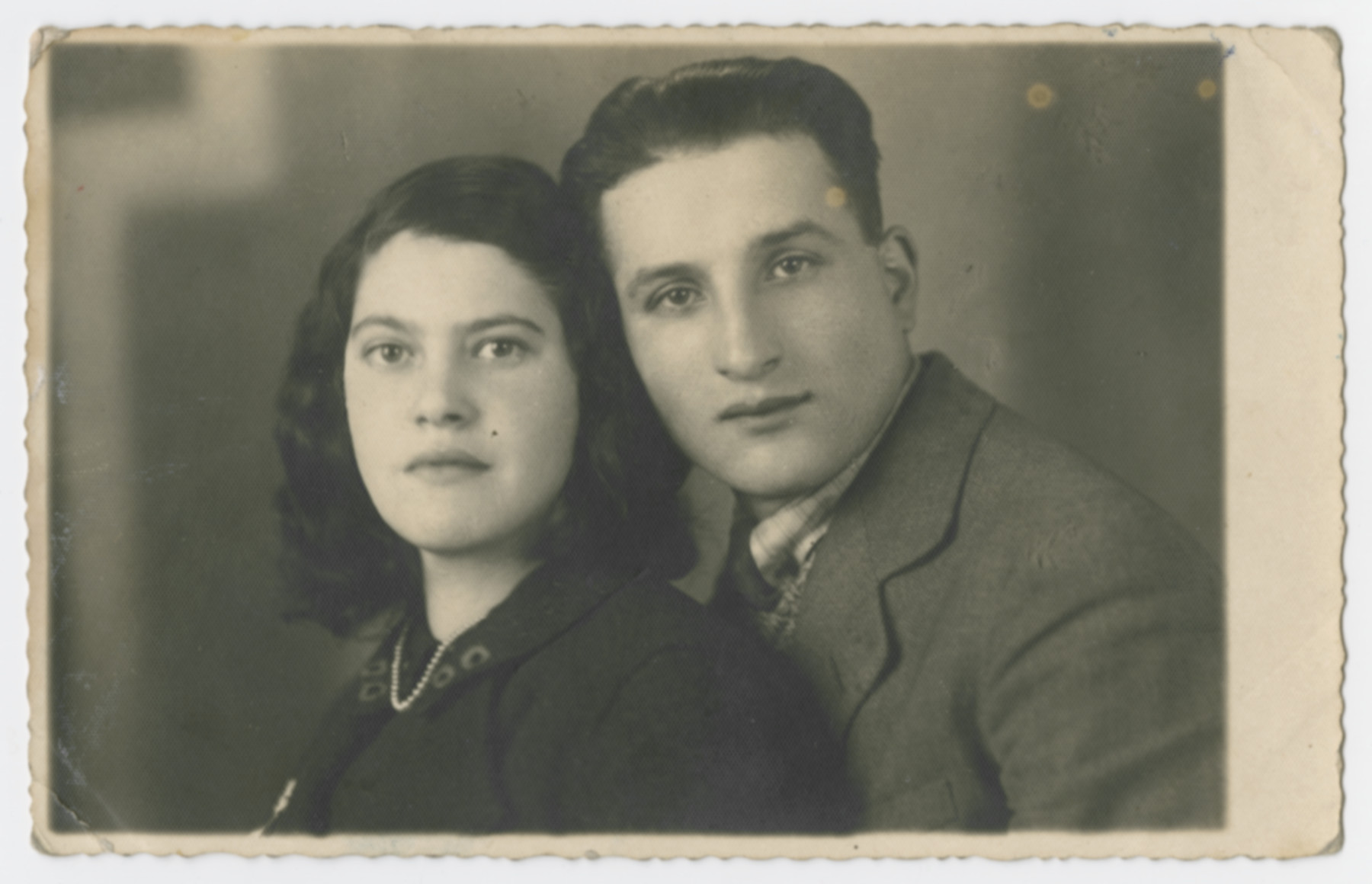 "Close-up portrait of Hela and Chaim (last names uknown) in the Sosnowiec ghetto.  The original caption reads: ""I offer my image to you, the young, nice couple Hanka and David, as an eternal souvenir.  Hela and Chaim."""