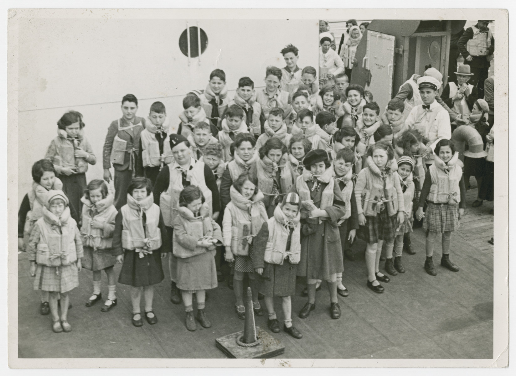 Austrian Jewish children being transported to the United States by Eleanor and Gilbert Kraus perform a life jacket drill aboard the President Harding.