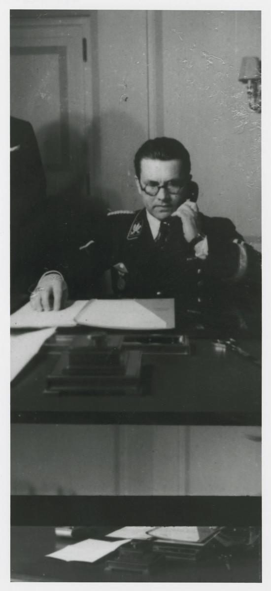 Philipp Bouhler works at his desk.