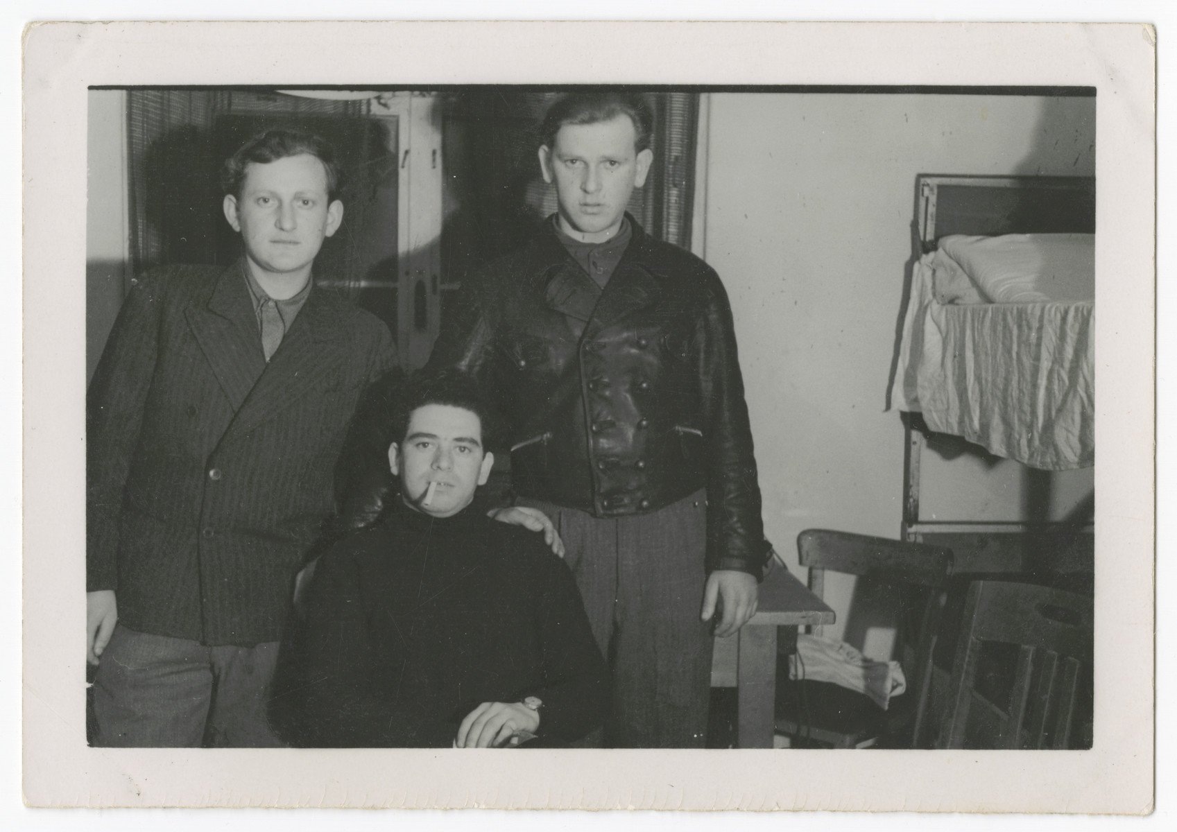 David Rosenzweig poses with his two cousins Ben and Joe Rosenzweig in their apartment in the Bergen-Belsen displaced persons camp.