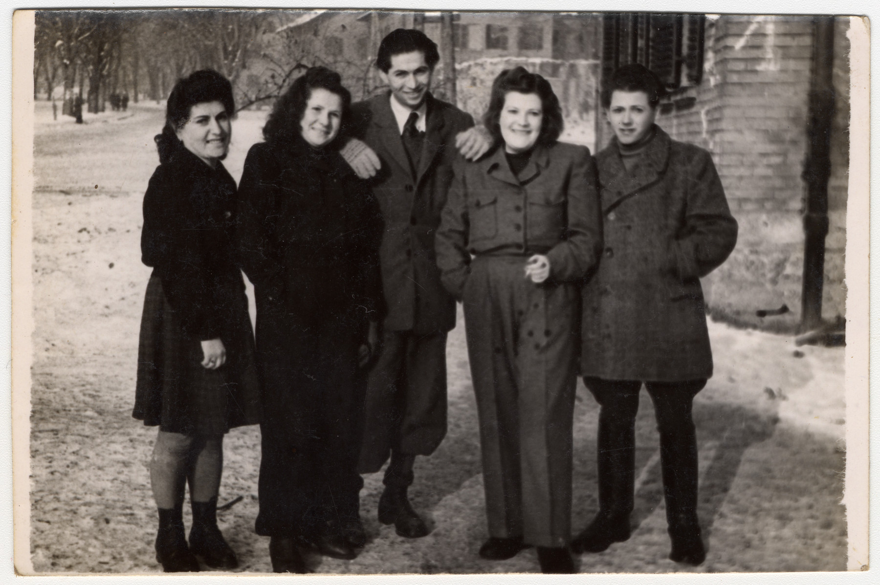 Group portrait of young adults in the Gabersee displaced persons camp.  Asher Zelig Slomowitz stands in the center.
