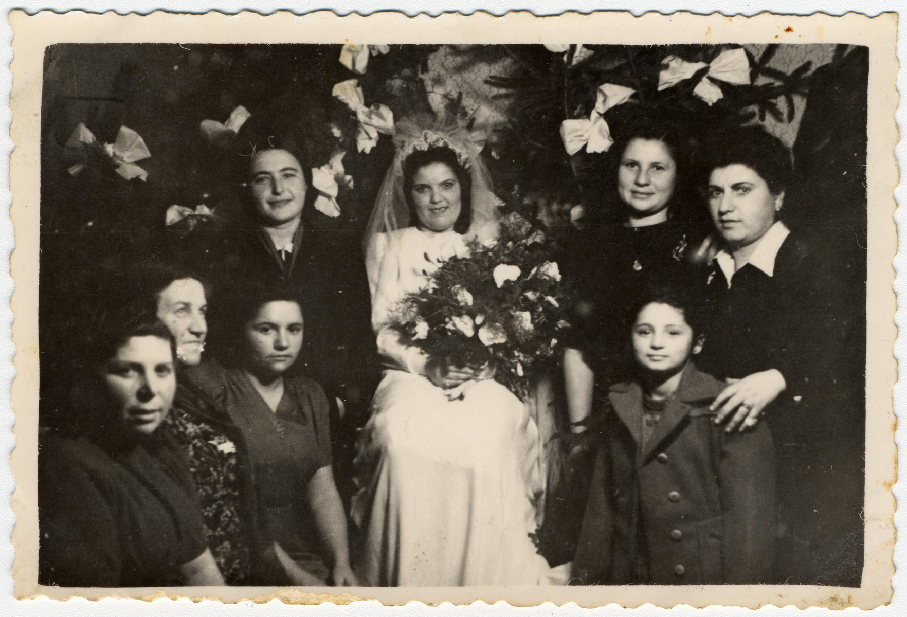 A group of women pose next to the bride during a wedding in the Gabersee displaced persons camp.