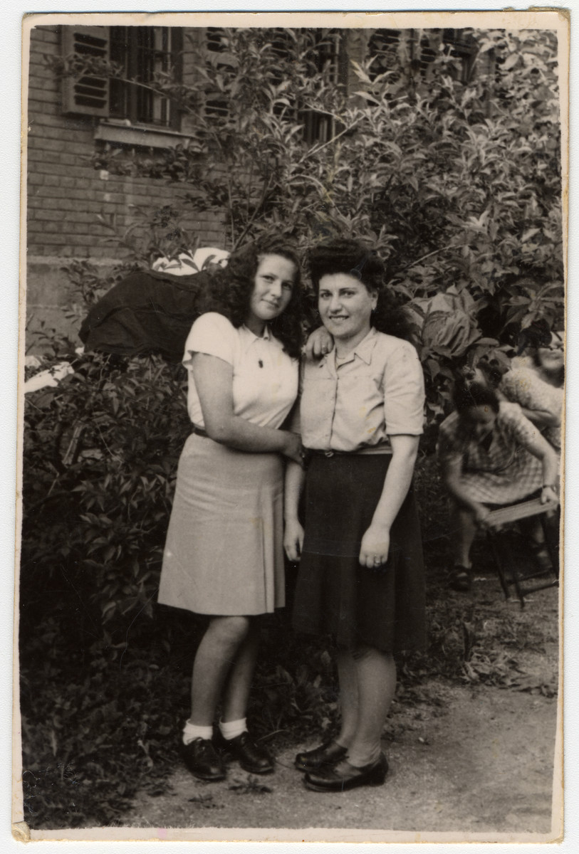 Sara (right) poses in the Gabersee displaced persons camp with her friend Amy.