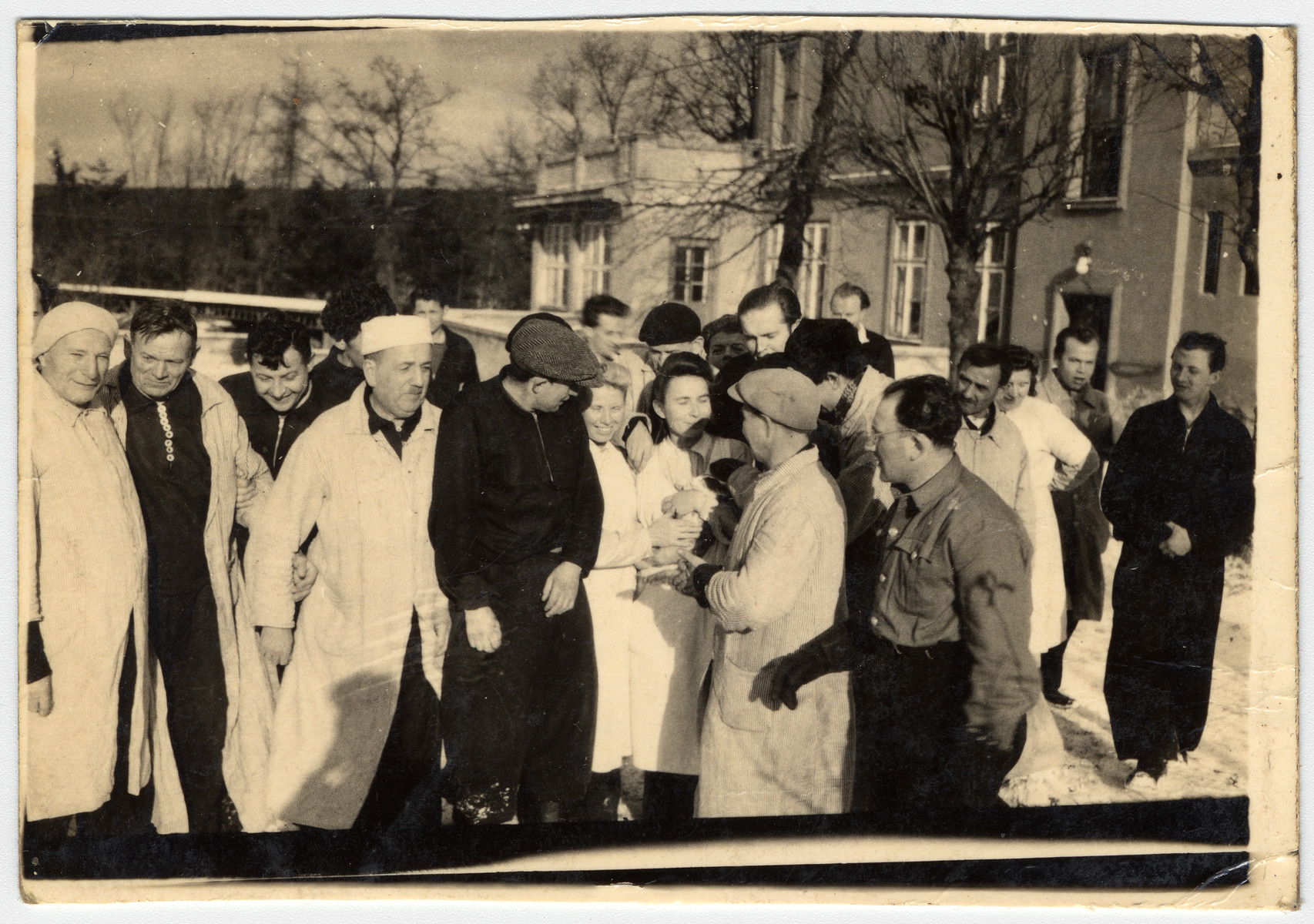 A group of Jewish displaced persons gather outside the Gabersee camp.