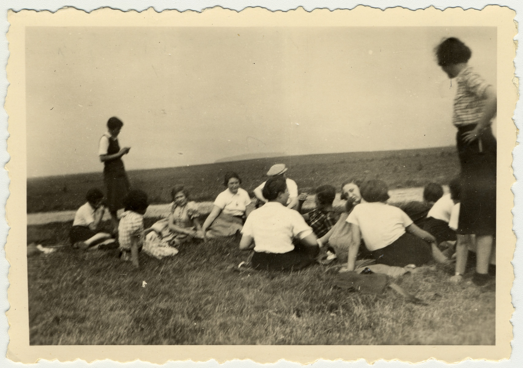Ruth Rappaport and her friends from the Zionist movement rest in a field in Vyzhnytsa..