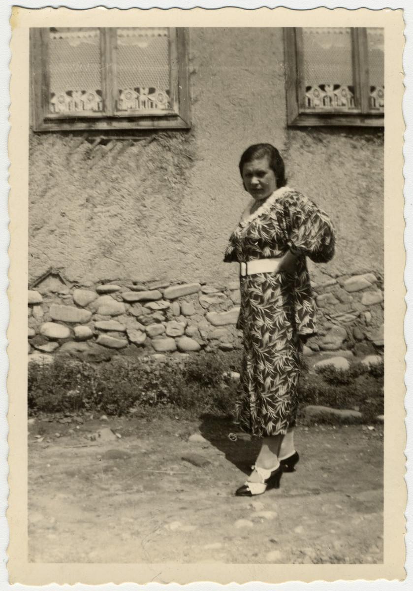 Frau Seiden poses in the streets of Vijnita for the camera.
