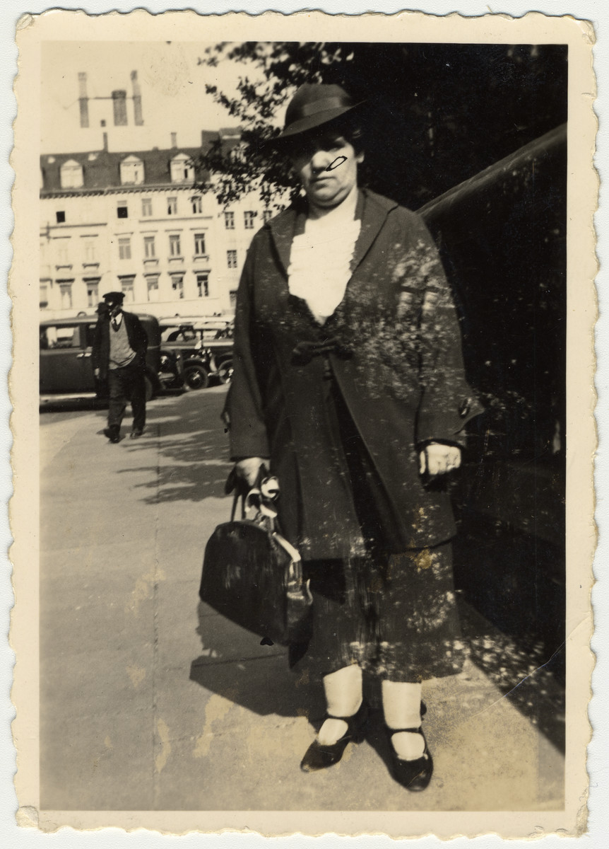 "Ruth Rappaport's mother poses on the street by ""Thomas Church"" in Leipzig."