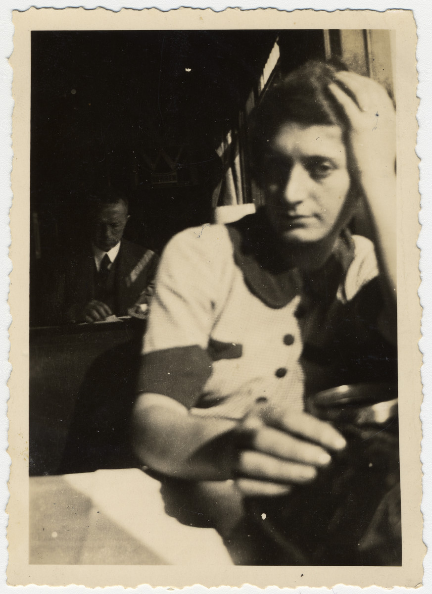 Fanny Rappaport sits for the camera in an express train's dining cart on her way to Romania.