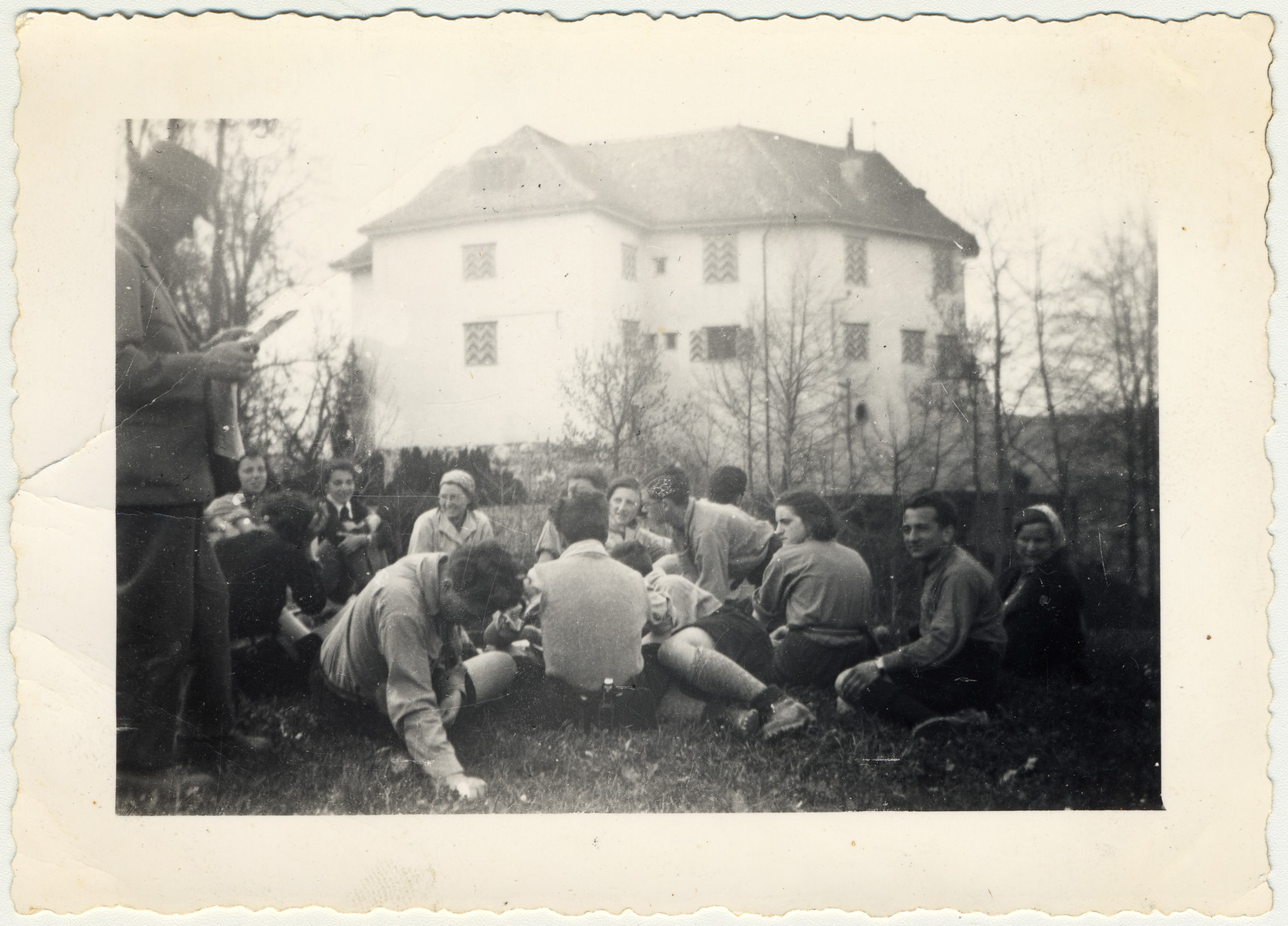 Zionist youth relax in the grass after work at Schloss von Elgg.