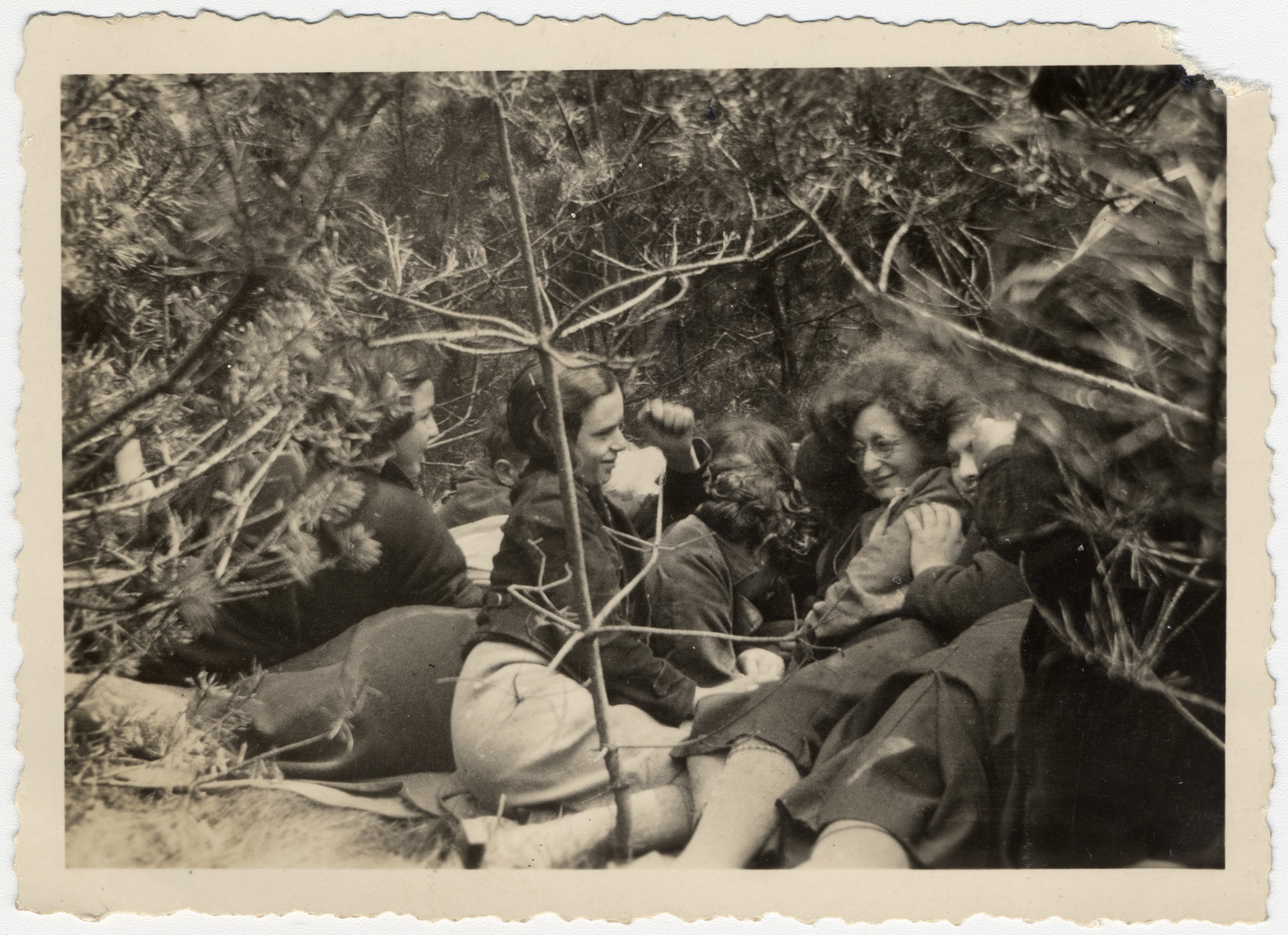 """A group of Zionist teeange girls rest during an excursion in the woods.  The orignal caption reads """"en route to freedom."""""""