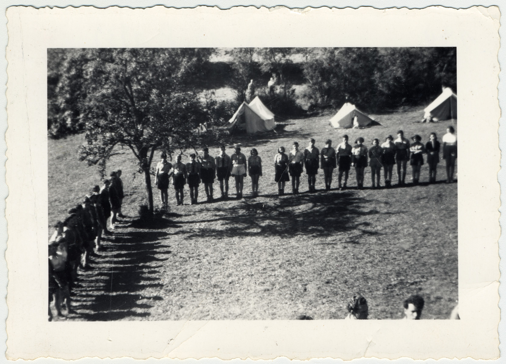 Zionist youth in Switzerland stand for morning roll call at a summer camp.