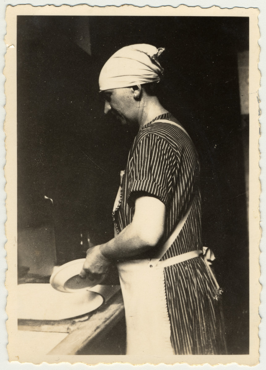 "The Rappaport's housemaid ""Else""  washes the dishes in their kitchen in Leipzig."