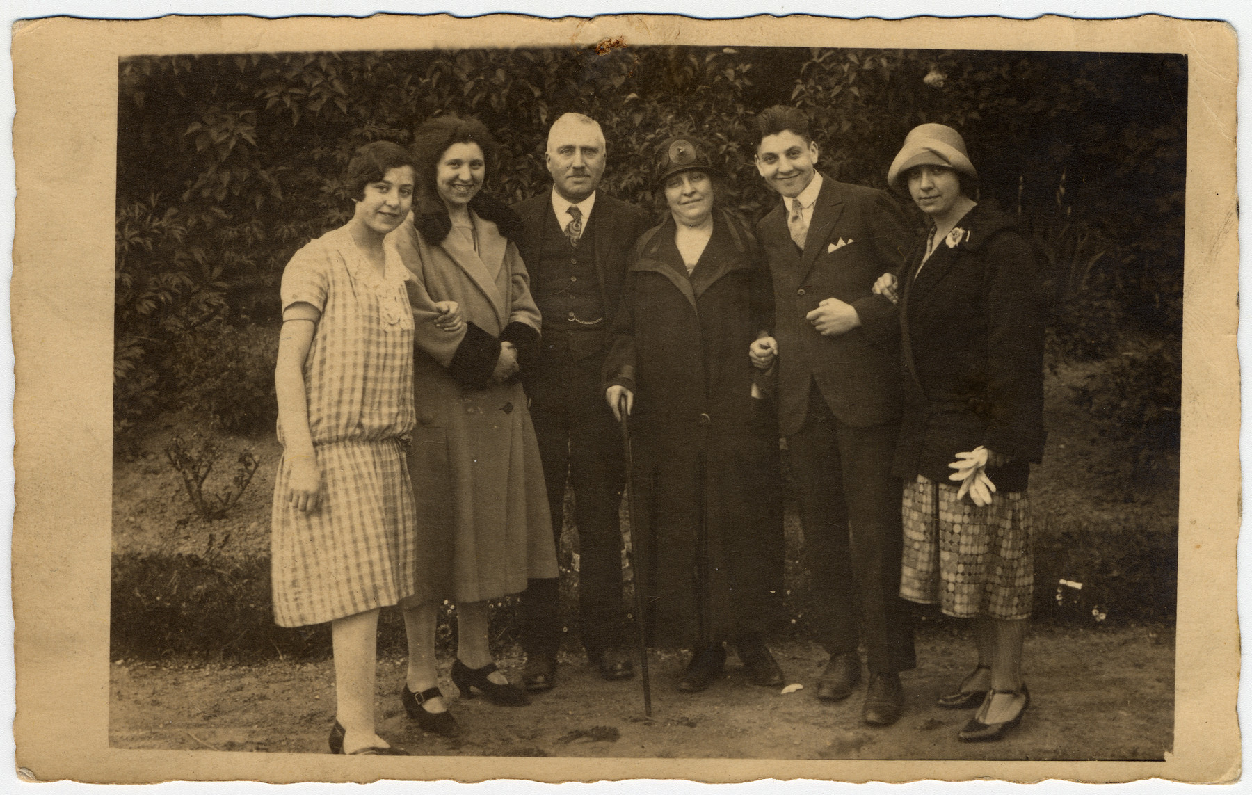 Group portrait of the Mendels family in The Netherlands.  Pictured from left to right are Greta Mendels-Levi (who survived the war in England), Dora Mendels-Spangenthal (who survived the war in an attic in Holland), Maurits Mendels and Rebecca Rosa Meibergen Mendels (who both perished), Siegfried Mendels (who immigrated to Palestine in the 1930s) and Trees (Theresa) Mendels (who was murdered in Sobibor).