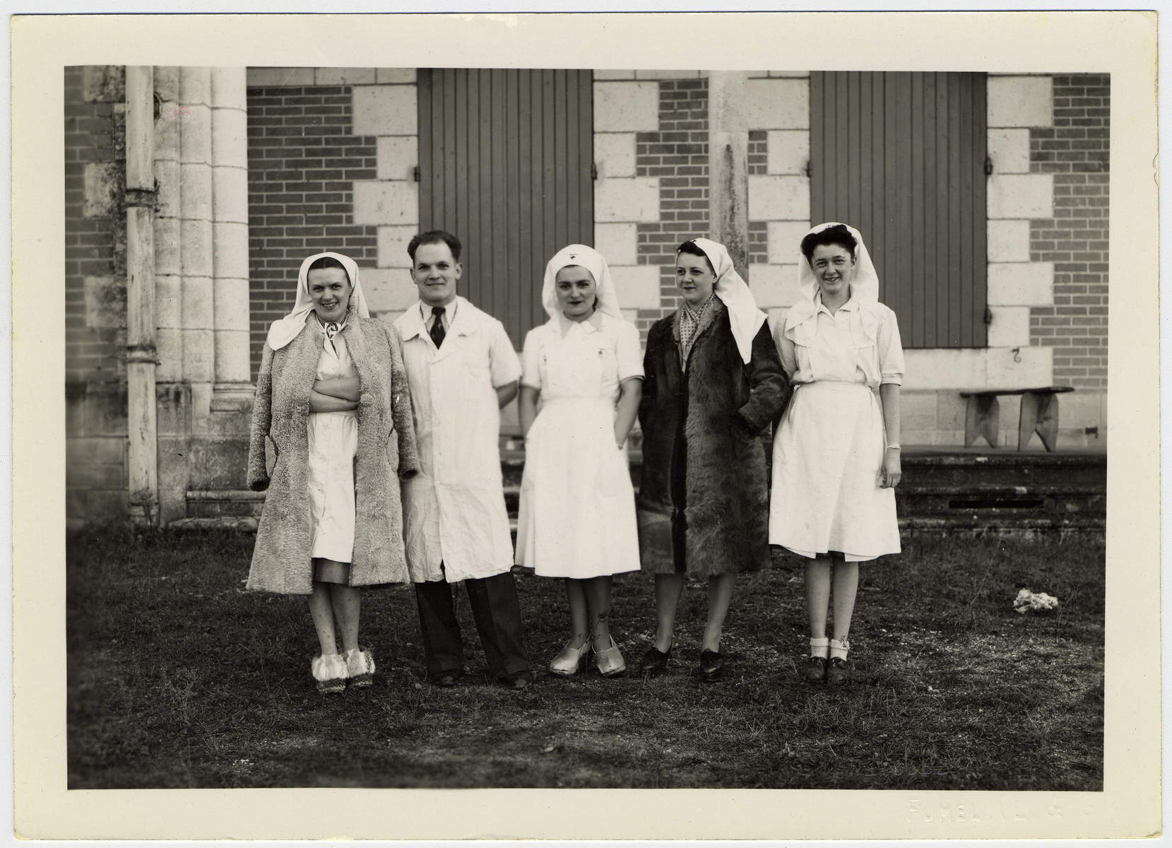 Nurses and doctors of the hospital Chateau du Boscla who ministered to members of the French resistance.  Among those pictured is Mrs. Genevieve Dizien (second from right).    Franklin Mendels, the brother of the donor (named after Franklin Roosevelt) was born in the same hospital while the family was in hiding nearby.  Pictured standing in the center is the director, Dr. Robert Boquet and his wife Genia Boquet.