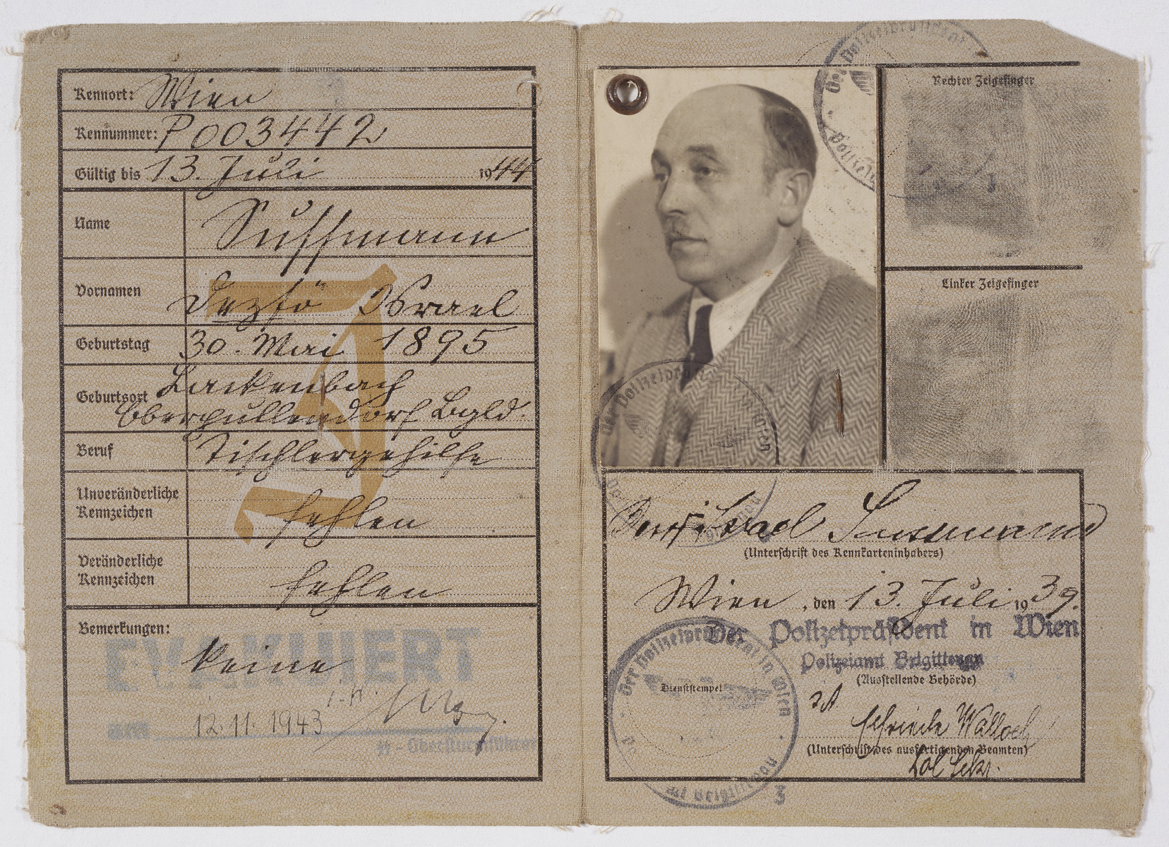 Identity card for Deszo Israel Sussman marked with a red J for Jude.  He was evacuated November 12, 1943.