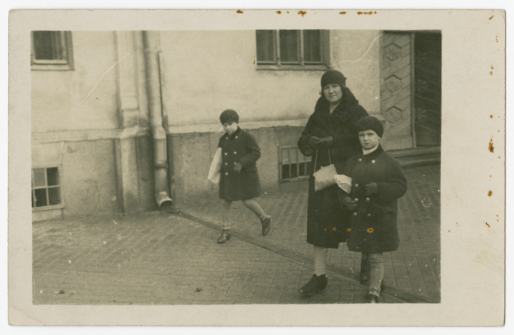 Therese Morawetz walks down a street with her two sons, Walter and Hans.