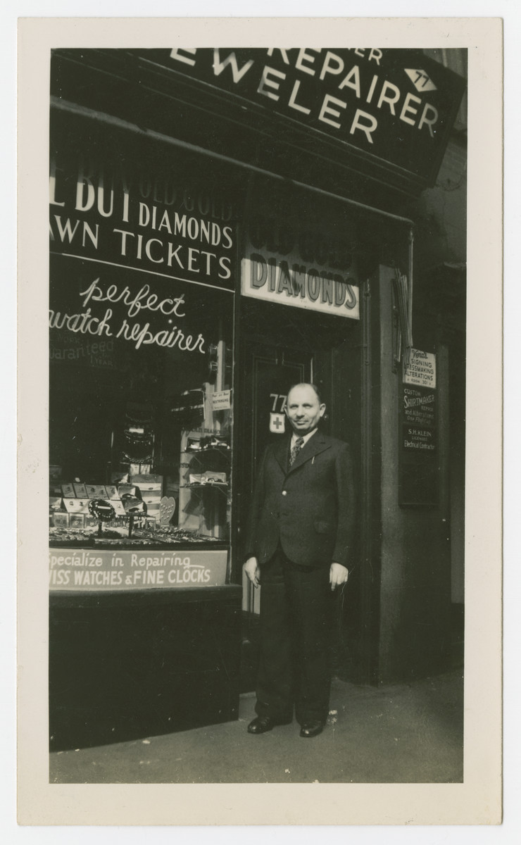 Erich Tauscher stands outside his watch and jewelry store.