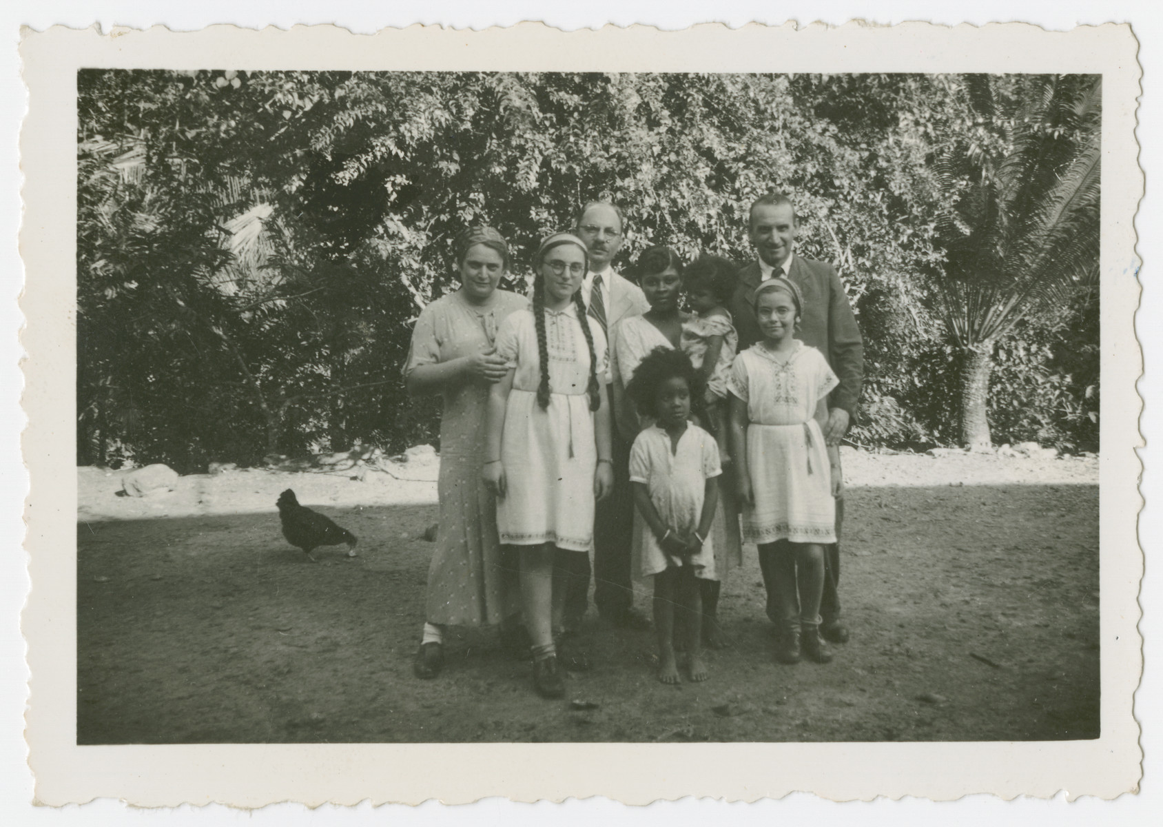 The Tauschers, (Austrian Jewish refugees)  pose with a Trinidadian family.