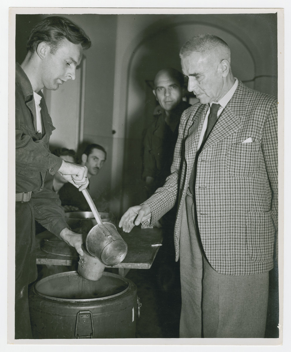 Wilhelm Frick receives a cup of water at the Nuremberg trials.