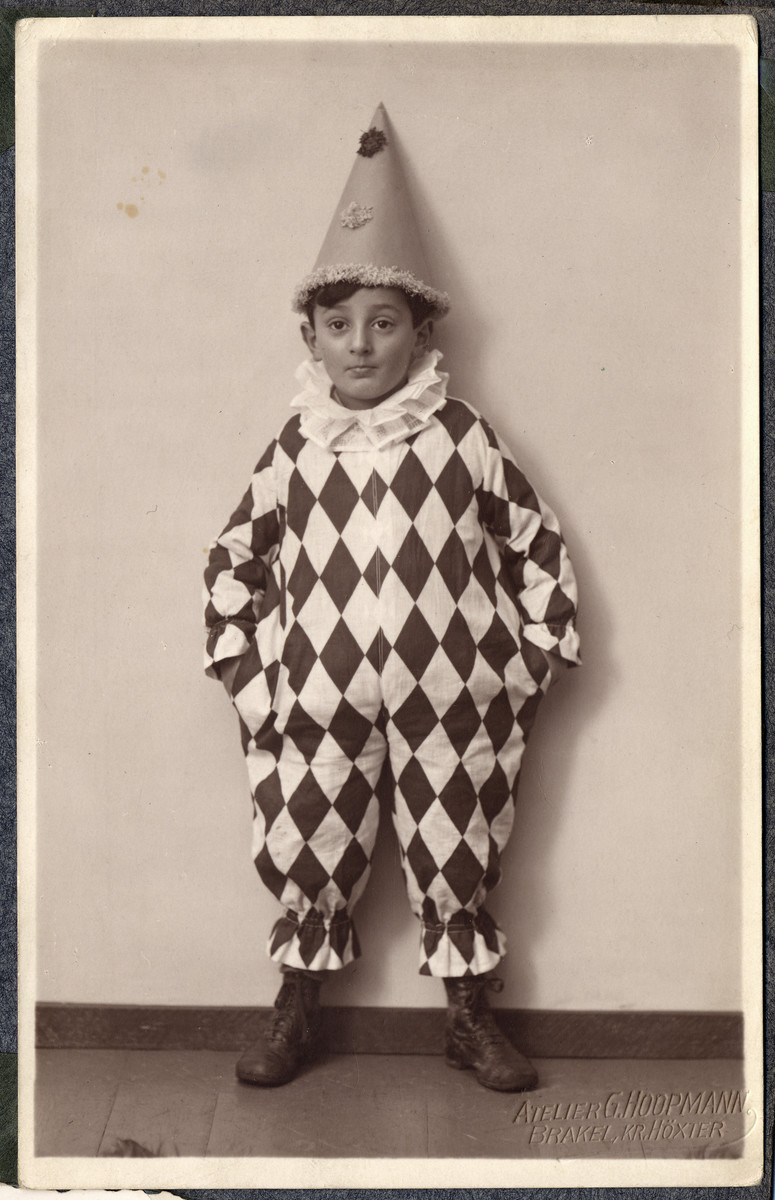 Close-up portrait of Martin Wertheim wearing a clown costume for Purim.
